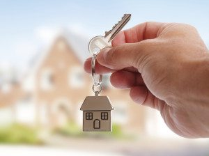 buyer holding house keys to new home