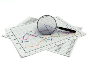 a line graph with a magnifying glass