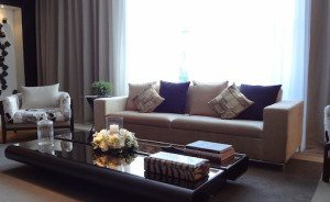 living room with couch and sheer curtains