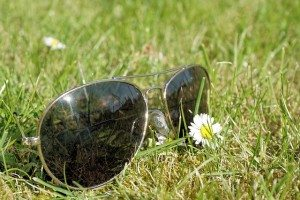 sunglasses laying in a grass field