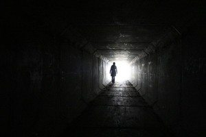 standing in a long dark hallway