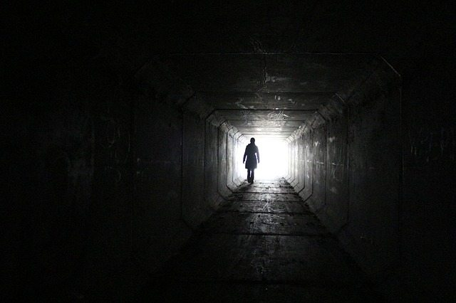 person at the light at the end of the tunnel