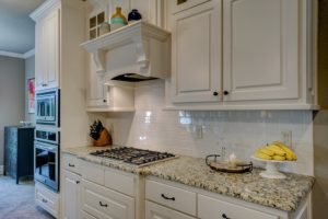 white tile backsplash in updated kitchen