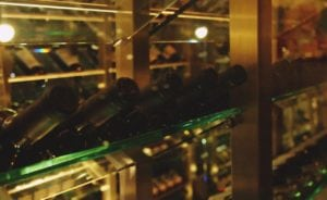 Wine cellar with glass bottles.