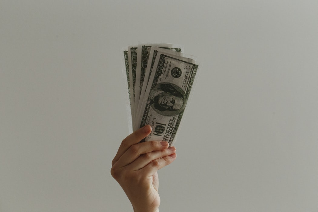 A person holding up money.