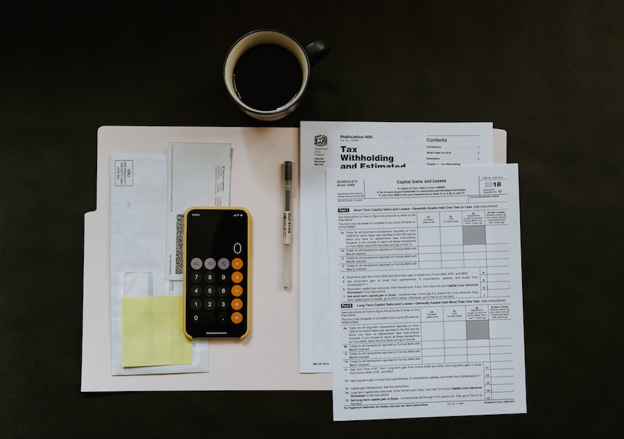 Tax forms with phone and coffee cup