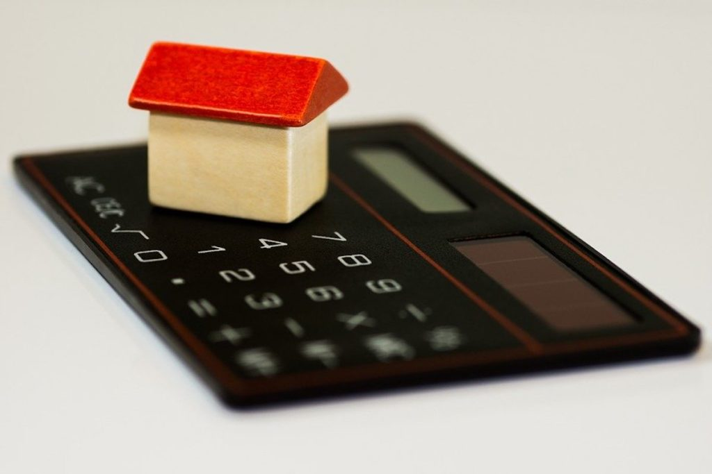 House figure on top of a calculator