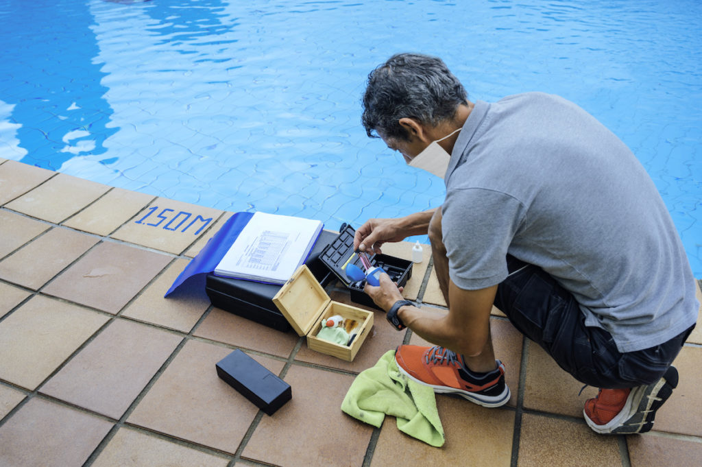 Checking a pool's chemical levels