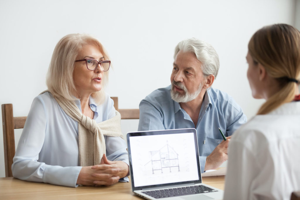Older couple talking about renovations