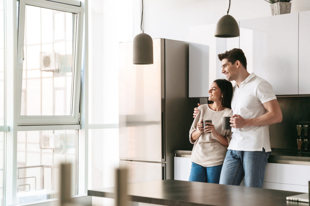 homeowners hugging in kitchen