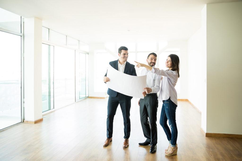 realtors reading property blueprint